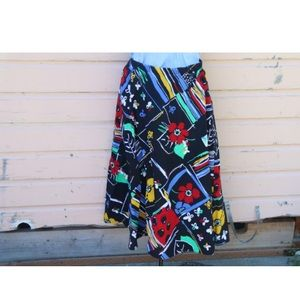 1980s does 1950s novelty circle skirt. Colorful